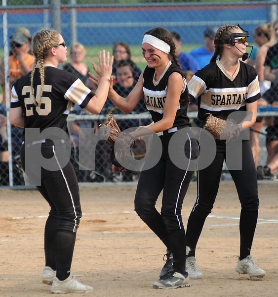 Milani Sablan (center) celebrates with her Sycamore teammates after getting out of a late inning jam on Friday.  Steve Bittinger - For Shaw Media