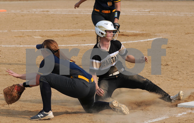 Spartan Gracyn Gabriel slides safely into third base during sectional final action against Sterling on Friday.  Steve Bittinger - For Shaw Media