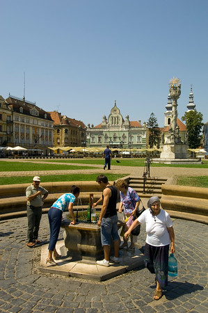 Local people drink water from a fountain on Piata Unirii, Timisoara, The Banat, Romania