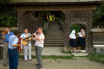 Village music band waiting for wedding party outside the church, Budesti, Maramures, Romania
