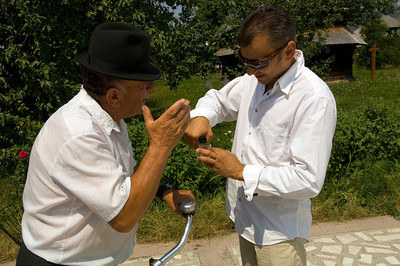 Man and guests are celebrating christening, Bogdan Voda, Maramures, Romania