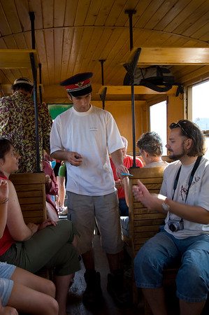 Tourists on board logging train passing through Vaser Valley, Maramures, Romania