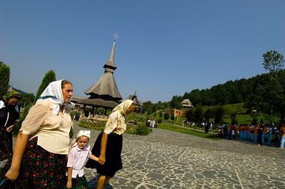Worshippers dressed in traditional Maramures dress attend open air mass, Barsana Monastery, Barsana, Maramures, Romania