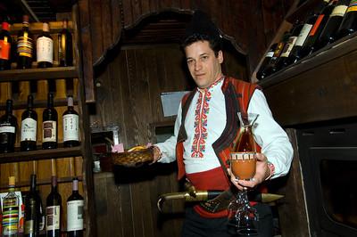 Waiter dressed in folk costume, Restaurant serving traditional Bulgarian dishes, Bansko, Pirin Mountains, Bulgaria