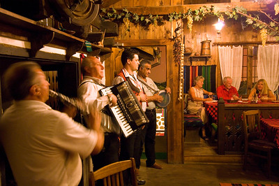 Music band playing to diners, Restaurant serving traditional Bulgarian dishes, Bansko, Pirin Mountains, Bulgaria