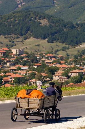 Farmer couple on donkey drawn cart  in Eastern Rhodope Mountains, Bulgaria