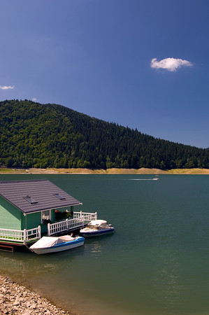 Floating house on Bicaz Lake, Moldavia, Romania