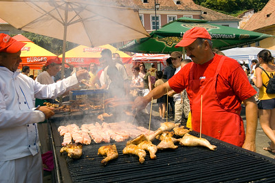 Grilled food on sale, market day, Sighisoara, Transylvania, Romania