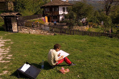 Art student drawing on a school trip, Bozhentsi, Bulgaria