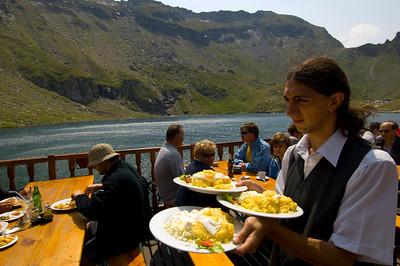 Restaurant at cabana by Balea Lac overlooking the lake, Fagaras Mountains, Transylvania, Romania
