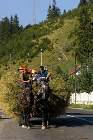 Farmers after hay harvest, Ghimes village, Trotus valley, Moldavia, Romania