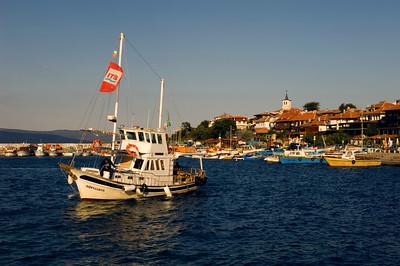 Taxi boat carring visitors from Sunny Beach enters marina, Nesebar, Black Sea coast, Bulgaria