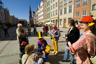 Child entertainer with kids on Dlugi Targ, Old Town, Gdansk, Poland