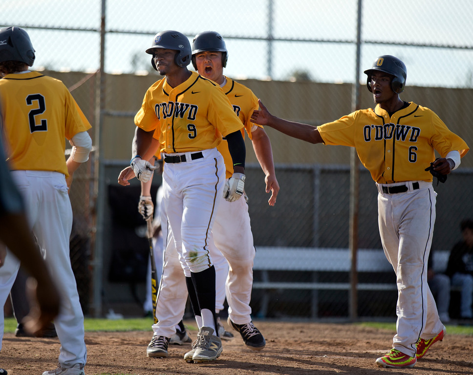 . Bishop O\'Dowd\'s Otis Statum (9) is congratulated by teammates Jared Bannister (20) and Jalen Bustos (6) after hitting a go-ahead, three-run home run against Encinal during the fifth inning of a high school baseball game, Wednesday, April 20, 2016, in Alameda, Calif. O\'Dowd won, 7-4. (D. Ross Cameron/Bay Area News Group)