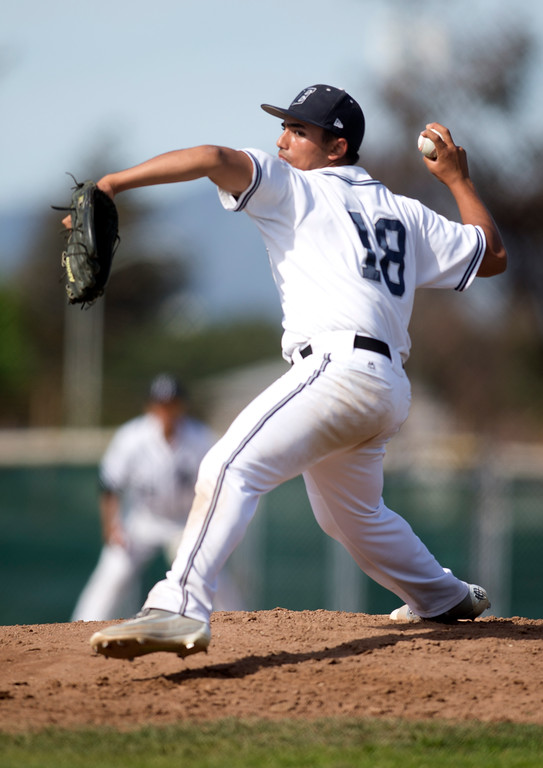 . Encinal starting pitcher Sandeep Mahl (18) delivers against Bishop O\'Dowd during the third inning of a high school baseball game, Wednesday, April 20, 2016, in Alameda, Calif. O\'Dowd won, 7-4. (D. Ross Cameron/Bay Area News Group)
