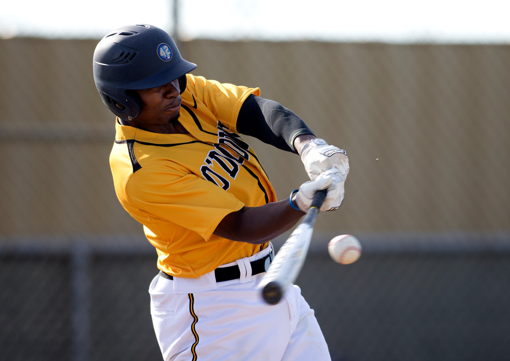 . Bishop O\'Dowd\'s Otis Statum connects for a three-run home run against Encinal during the fifth inning of a high school baseball game, Wednesday, April 20, 2016, in Alameda, Calif. O\'Dowd won, 7-4. (D. Ross Cameron/Bay Area News Group)