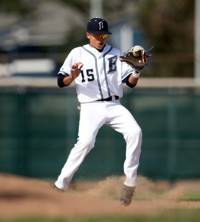 . Encinal shortstop Ricky Marquez handles a tough hop on a Bishop O\'Dowd grounder during the fourth inning of a high school baseball game, Wednesday, April 20, 2016, in Alameda, Calif. O\'Dowd won, 7-4. (D. Ross Cameron/Bay Area News Group)