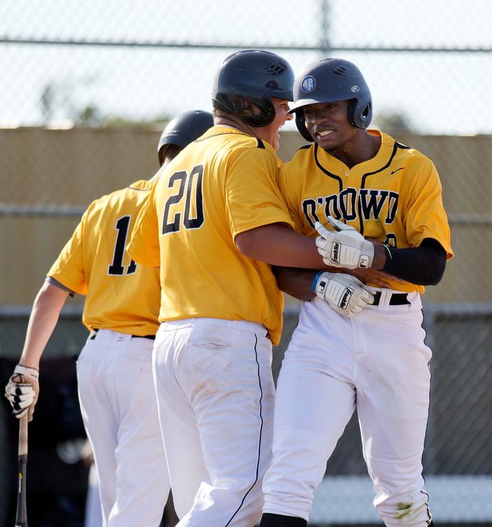 . Bishop O\'Dowd\'s Otis Statum (9) is congratulated by teammate Jared Bannister (20) after hitting a go-ahead, three-run home run against Encinal during the fifth inning of a high school baseball game, Wednesday, April 20, 2016, in Alameda, Calif. O\'Dowd won, 7-4. (D. Ross Cameron/Bay Area News Group)