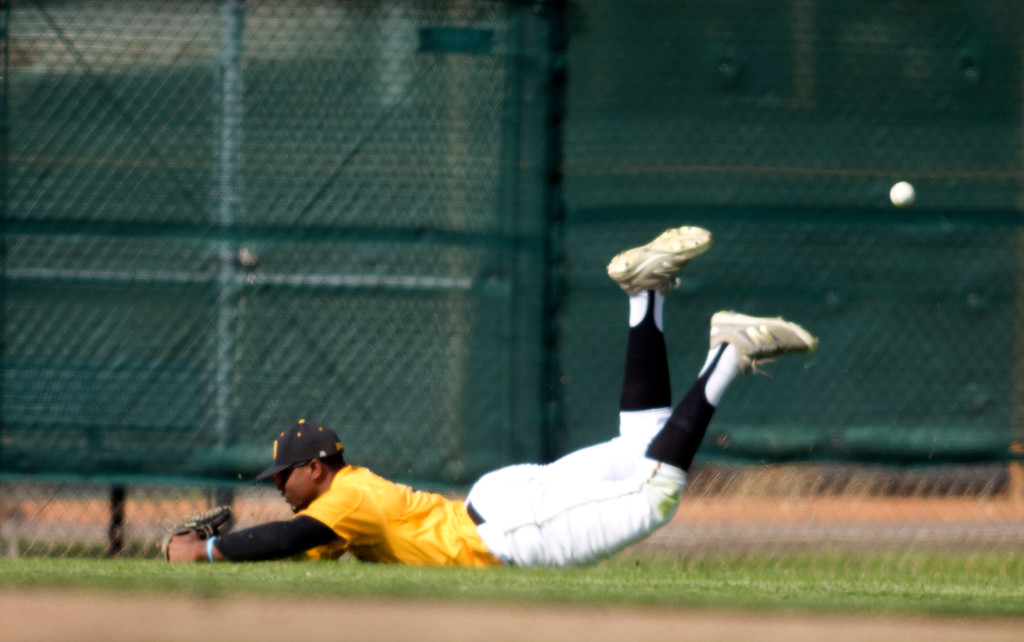 . Bishop O\'Dowd center fielder Otis Statum dives in vain for a double off the bat of Encinal\'s Zach Repsold, during the second inning of a high school baseball game, Wednesday, April 20, 2016, in Alameda, Calif. O\'Dowd won, 7-4. (D. Ross Cameron/Bay Area News Group)