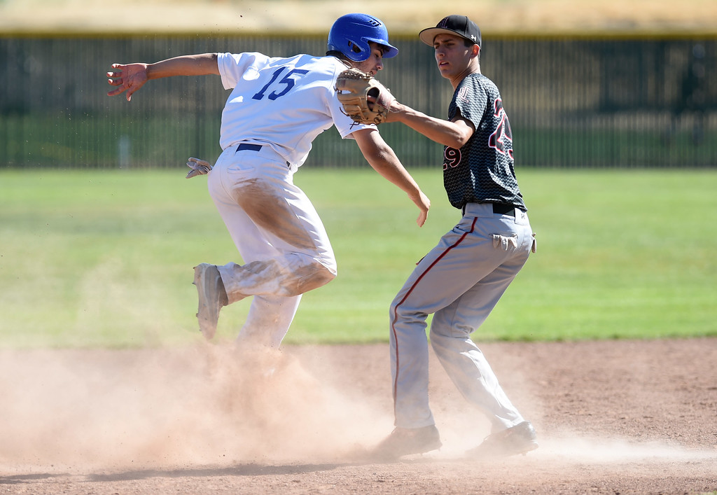 . Clayton Valley Charter\'s Jack Miller is out trying to steal second base as James Logan\'s Rogelio Reyes (29) makes the play during their game in the first round of the North Coast Section Division 1 Baseball Tournament in Concord, Calif., on Wednesday, May 25, 2016. (Susan Tripp Pollard/Bay Area News Group)