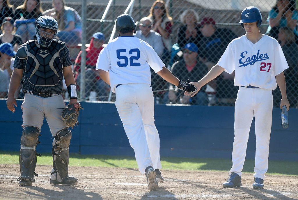 . Clayton Valley Charter\'s James Biles, (52) celebrates scoring on a walk against James Logan with next at bat Andrew Abbott (27) in the first round of the North Coast Section Division 1 Baseball Tournament in Concord, Calif., on Wednesday, May 25, 2016. James Logan catcher Julian Ortiz (21) is at left. (Susan Tripp Pollard/Bay Area News Group)