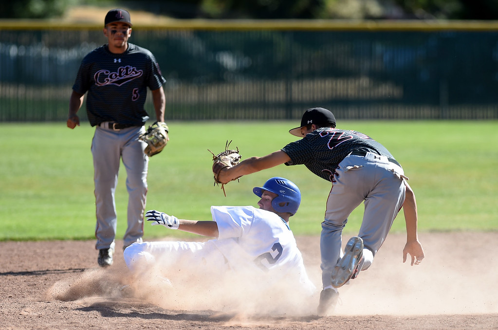 . James Logan\'s Rogelio Reyes (29) makes the play and Clayton Valley Charter\'s Milan Mijanovic (2) is out as he tries to steal second base in their game in the first round of the North Coast Section Division 1 Baseball Tournament in Concord, Calif., on Wednesday, May 25, 2016. James Logan\'s Chris Ramos (5) backs up the play. (Susan Tripp Pollard/Bay Area News Group)