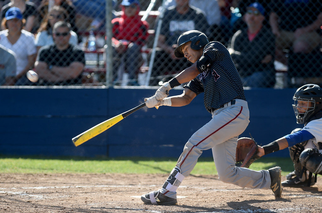 . James Logan\'s Jordan Soto (11) hits a sacrifice fly scoring Manuel Ochoa and their only run against Clayton Valley Charter in their game in the first round of the North Coast Section Division 1 Baseball Tournament in Concord, Calif., on Wednesday, May 25, 2016. (Susan Tripp Pollard/Bay Area News Group)