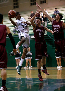 Palo Alto High School's Aubrey Dawkins (33) takes a shot against Cupertino High School's Jeffrey Liando (5) and Javier Licardie (55) in the second period at Palo Alto High School in Palo Alto, Calif. on Tuesday, Jan. 15, 2013.  (Nhat V. Meyer/Staff)