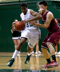 Palo Alto High School's Aubrey Dawkins (33) drives to the basket against Cupertino High School's Jeffrey Liando (5) in the second period at Palo Alto High School in Palo Alto, Calif. on Tuesday, Jan. 15, 2013.  (Nhat V. Meyer/Staff)