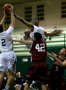 Palo Alto High School's Aubrey Dawkins (33) tries to grab a rebound with Palo Alto's Keller Chryst (2) against Cupertino High School's John Siano (42) and Cupertino's Charles Liu (3) in the first period at Palo Alto High School in Palo Alto, Calif. on Tuesday, Jan. 15, 2013.  (Nhat V. Meyer/Staff)
