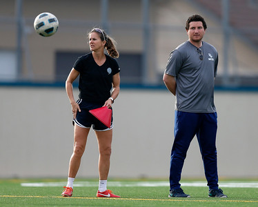 Bellarmine College Prep's Brandi Chastain, assistant coach of the varsity soccer team, and head coach Conor Salcido watch players during practice on the Bellarmine College Prep soccer field in San Jose, Calif., on Tuesday, Feb. 9, 2016. (Nhat V. Meyer/Bay Area News Group)