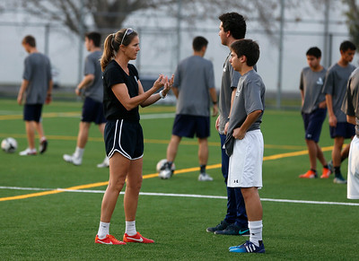 Bellarmine College Prep's Brandi Chastain, assistant coach of the varsity soccer team, talks with Joey Rubino after varsity soccer practice on the Bellarmine College Prep soccer field in San Jose, Calif., on Tuesday, Feb. 9, 2016. (Nhat V. Meyer/Bay Area News Group)