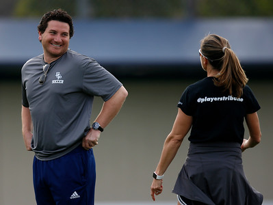 Bellarmine College Prep head coach Conor Salcido, left, talks with Brandi Chastain, assistant coach of the varsity soccer team, yells during practice on the Bellarmine College Prep soccer field in San Jose, Calif., on Tuesday, Feb. 9, 2016. (Nhat V. Meyer/Bay Area News Group)