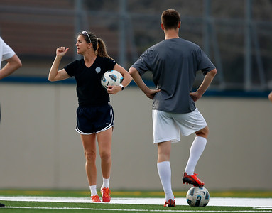 Bellarmine College Prep's Brandi Chastain, assistant coach of the varsity soccer team, talks to players during practice on the Bellarmine College Prep soccer field in San Jose, Calif., on Tuesday, Feb. 9, 2016. (Nhat V. Meyer/Bay Area News Group)