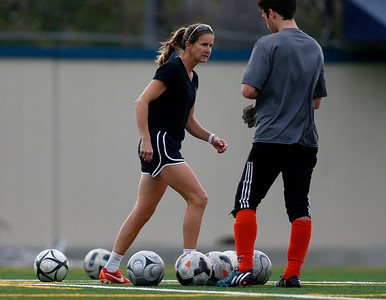 Bellarmine College Prep's Brandi Chastain, assistant coach of the varsity soccer team, walks through some soccer balls during practice on the Bellarmine College Prep soccer field in San Jose, Calif., on Tuesday, Feb. 9, 2016. (Nhat V. Meyer/Bay Area News Group)