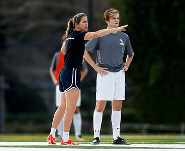 Bellarmine College Prep's Brandi Chastain, assistant coach of the varsity soccer team, talks to Connor Brady during practice on the Bellarmine College Prep soccer field in San Jose, Calif., on Tuesday, Feb. 9, 2016. (Nhat V. Meyer/Bay Area News Group)
