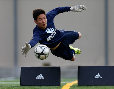 Bellarmine College Prep goalkeeper Andrew Song makes a diving save during drills during varsity soccer practice on the Bellarmine College Prep soccer field in San Jose, Calif., on Tuesday, Feb. 9, 2016. (Nhat V. Meyer/Bay Area News Group)