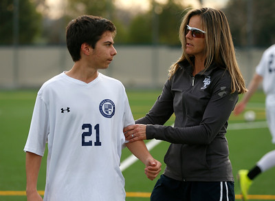 Bellarmine College Prep's Brandi Chastain, assistant coach of the varsity soccer team, checks out Joey Rubino during practice on the Bellarmine College Prep soccer field in San Jose, Calif., on Tuesday, Feb. 9, 2016. (Nhat V. Meyer/Bay Area News Group)
