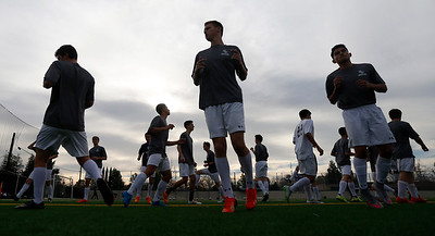 The Bellarmine College Prep varsity soccer team warms-up for practice on the Bellarmine College Prep soccer field in San Jose, Calif., on Tuesday, Feb. 9, 2016. (Nhat V. Meyer/Bay Area News Group)