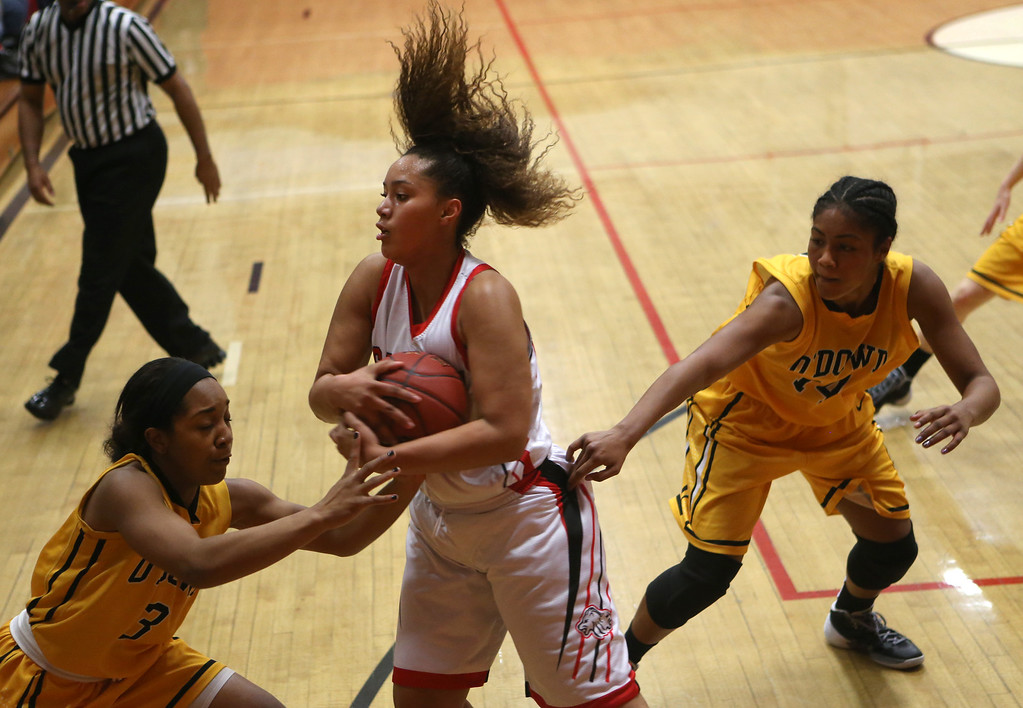 . Bishop O\'Dowd\'s (3) and Daniella Williams (14) pressure Salesian\'s  Alana Horton (10) during a nonleague game at Salesian High School in Richmond, Calif., on Saturday, Jan. 11, 2014. Bishop O\'Dowd won 60-56. (Ray Chavez/Bay Area New Group)