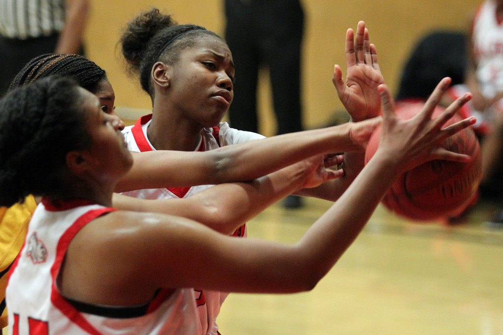 . Bishop O\'Dowd\'s Myah Pace (21) struggles against  Salesian\'s Zoe Correal (15) and Deja Stallworth (33) on a rebound during a nonleague game at Salesian High School in Richmond, Calif., on Saturday, Jan. 11, 2014. Bishop O\'Dowd won 60-56. (Ray Chavez/Bay Area New Group)