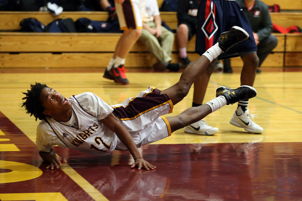 . Las Lomas\' Rob Prince (12) ends up on the floor after attempting a shot against Dublin High in the first half of a Diablo Foothill Athletic League boys basketball game at Las Lomas High School in Walnut Creek, Calif., on Friday, Feb. 5, 2016. (Ray Chavez/Bay Area News Group)