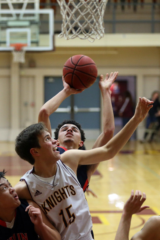 . Dublin\'s Steven Houston (24) makes a shot against Las Lomas\' Danny Oliner (15) in the first half of a Diablo Foothill Athletic League boys basketball game at Las Lomas High School in Walnut Creek, Calif., on Friday, Feb. 5, 2016. Dublin won 66-47. (Ray Chavez/Bay Area News Group)