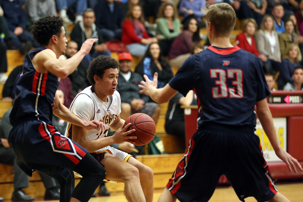 . Las Lomas\' Devin Payne (23) dribbles against Dublin\'s Steven Houston (24) and Jack Nielsen (33) in the first half of a Diablo Foothill Athletic League boys basketball game at Las Lomas High School in Walnut Creek, Calif., on Friday, Feb. 5, 2016. (Ray Chavez/Bay Area News Group)