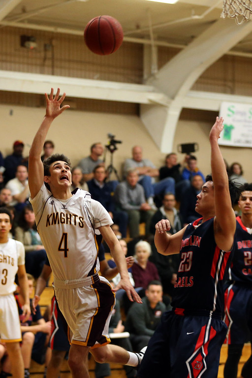 . Las Lomas\' Tanner Wallace (4) makes a shot against Dublin\'s Cody Chang (23) in the first half of a Diablo Foothill Athletic League boys basketball game at Las Lomas High School in Walnut Creek, Calif., on Friday, Feb. 5, 2016. (Ray Chavez/Bay Area News Group)