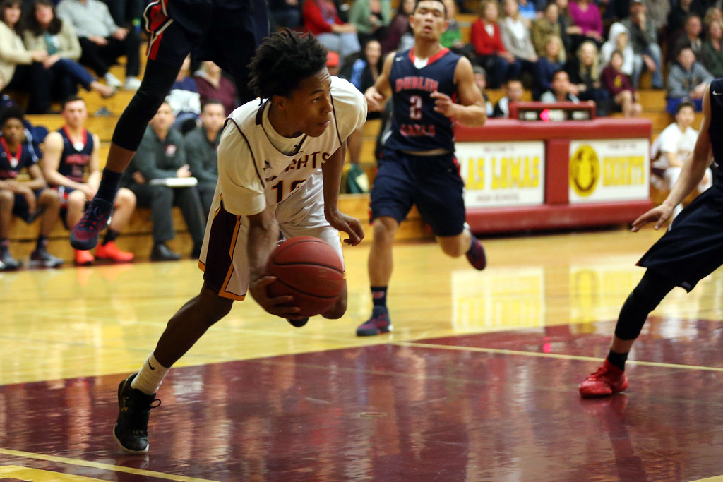 . Las Lomas\' Rob Prince (12) looks to pass the ball against Dublin High in the first half of a Diablo Foothill Athletic League boys basketball game at Las Lomas High School in Walnut Creek, Calif., on Friday, Feb. 5, 2016. (Ray Chavez/Bay Area News Group)