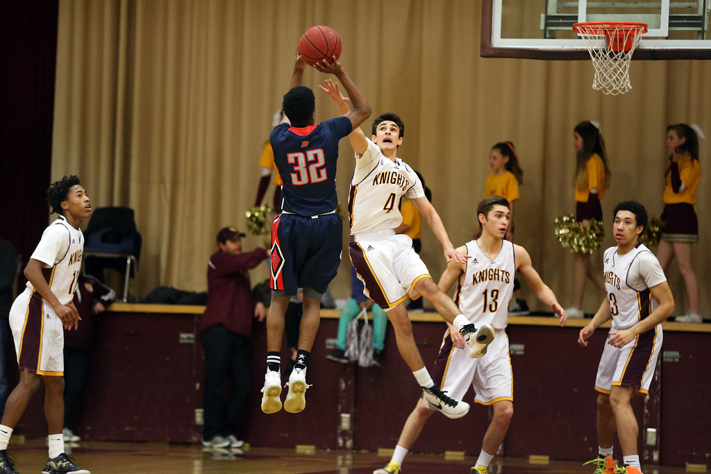. Dublin\'s Kobe Toney (32) puts up a shot against Las Lomas\' Tanner Wallace (4) in the first half of a Diablo Foothill Athletic League boys basketball game at Las Lomas High School in Walnut Creek, Calif., on Friday, Feb. 5, 2016. (Ray Chavez/Bay Area News Group)