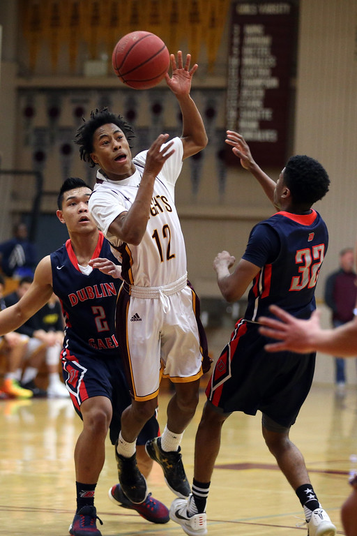 . Las Lomas\' Rob Prince (12) attempts to drive between Dublin\'s Andrew Nguyen (2) and Kobe Toney (32) in the first half of a Diablo Foothill Athletic League boys basketball game at Las Lomas High School in Walnut Creek, Calif., on Friday, Feb. 5, 2016. (Ray Chavez/Bay Area News Group)