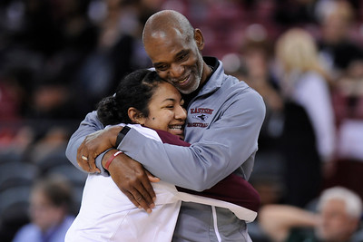 Eastside College Prep head coach Donvan Blythe hugs his player Kayla Tahaafe (5) as they celebrate their win against Village Christian during their CIF Division V state championship girls basketball game at Sleep Train Arena in Sacramento, Calif., on Thursday, March 24, 2016. Eastside College Prep defeated Village Christian 57-50. (Jose Carlos Fajardo/Bay Area News Group)