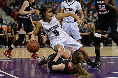 Eastside College Prep's Kayla Tahaafe (5) tumbles over Village Christian's Avery O'Neal (5) in the second quarter of their CIF Division V state championship girls basketball game at Sleep Train Arena in Sacramento, Calif., on Thursday, March 24, 2016. (Jose Carlos Fajardo/Bay Area News Group)